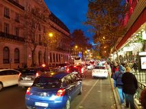 Boulevard Haussmann, Paris. Dusk view on a busy Boulevard Haussmann, next to Galeries Lafayette stock images