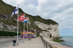 Boulevard near vertical limestone cliffs of Yport in Normandie, France Royalty Free Stock Image