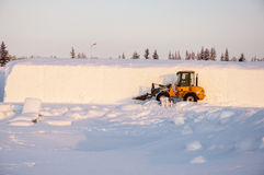 Boulldozer on snow Royalty Free Stock Images