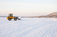 Boulldozer on snow Stock Photography