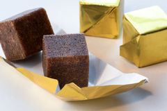 Boullion cubes. Beef bouillon cubes in gold cellophane Stock Photography