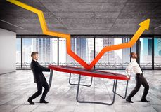 Bounce the crisis. Businessmen bounce an arrow on a trampoline Stock Images