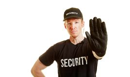 Bouncer with hand on top as a sign to stop. Bouncer / security guard with hand on top as a sign to stop royalty free stock images