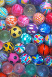 Bouncing Balls. Bunch of various bouncing balls for kids stock image