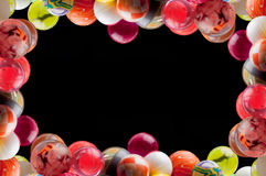Bouncing balls frame. Black background stock photography