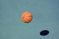 Bouncing Basketball. Ball in asphalt Royalty Free Stock Photos