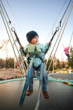 Bouncing in bungee trampoline. Child bouncing in bungee trampoline in amusement park Stock Photography