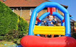 Bouncing castle. Child jumping in a colorful bouncing castle Stock Photo