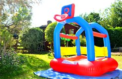Bouncing castle. Colorful bouncing castle in the garden Royalty Free Stock Image