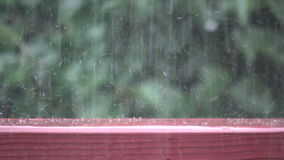 Bouncing raindrops in slow motion stock footage