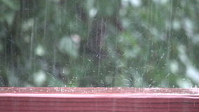 Bouncing raindrops in slow motion stock video