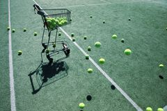 Bouncing tennis balls. Cart and bouncing tennis balls royalty free stock image