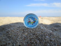 Bouncy Ball in the sand Stock Images
