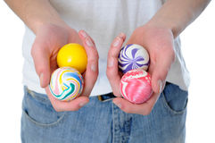 Bouncy balls. Hand holding a set of four round bouncy rubber balls with colorful designs on them royalty free stock photography