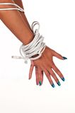 Bound. Woman's hands bound with Ethernet cable Royalty Free Stock Images