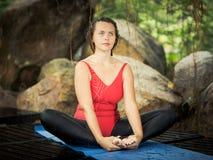 Bound angle pose. Baddha Konasana. Woman is practicing yoga outdoor. Bound angle pose. Baddha Konasana Royalty Free Stock Photos