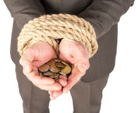 Bound hands with coins Royalty Free Stock Photography