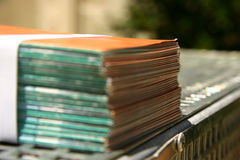 Bound leaflets at a printer. Bound leaflets ready for delivery at a printer Royalty Free Stock Photo