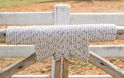Bound with rope knot and wooden as fence in farmland. Stock Photo
