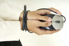 Bound By Technology 2. A young woman's hands are tied up by the mouse cable Stock Image