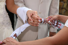 Bound together wedding hand towel bride and groom Royalty Free Stock Image