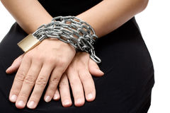 Bound Woman. Woman in a black dress bound with chain and padlock. White background stock photos
