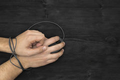 Bound wrist by computer mouse cable Royalty Free Stock Images