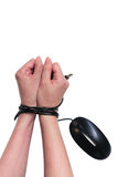 Bound wrist by mouse cable Royalty Free Stock Photography