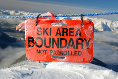 Boundary. A sign warns of a ski areas terrain limits Royalty Free Stock Photo