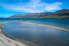 Boundary Creek hereinkommender See Wanaka Stockfoto