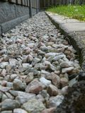 Garden boundary. Boundary in a garden created with stones stock images