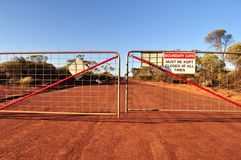 Boundary gate and road with closed sign Royalty Free Stock Images