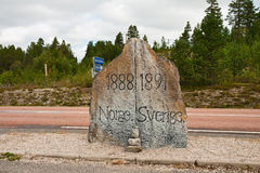 Boundary stone. Ancient boundary stone on border of Sweden and Norway stock photography