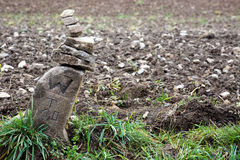 Boundary stone at a brown field Royalty Free Stock Photography