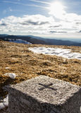 Boundary stone on hill Stock Photo