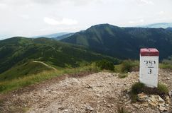Boundary stone with Poland in Rohace western Tatra mountains, Slovakia Royalty Free Stock Photo