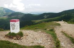 Boundary stone with Poland in Rohace western Tatra mountains, Slovakia. Boundary stone with Poland in Panorama view of Rohace in western Tatra mountains stock photography