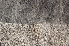 Boundary of two surfaces of natural  stone as background Royalty Free Stock Photography