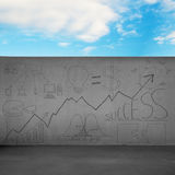 Boundary wall with business doodles and blue sky Royalty Free Stock Image
