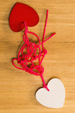 Bounding love. Two hearts bound together with pink thread Stock Photography