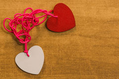 Bounding love. Two hearts bound together with pink thread Royalty Free Stock Images