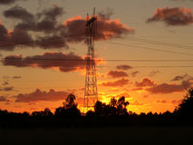 Boundless energy. Pylons in early morning and cloudy sky royalty free stock photography