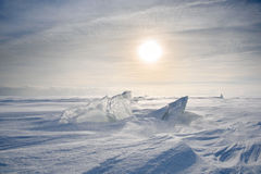 Boundless icy landscape during a snowstorm. At sunset in winter Stock Images