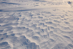 Boundless icy landscape during a snowstorm. At sunset in winter Stock Photo
