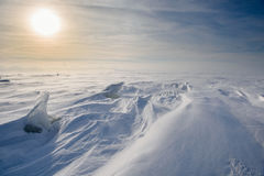 Boundless icy landscape during a snowstorm. At sunset in winter Stock Photos
