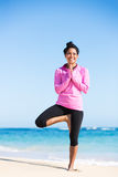 Boung woman in yoga pose at the beach Royalty Free Stock Image