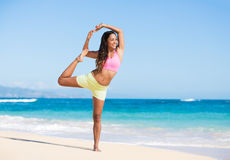 Boung woman in yoga pose at the beach Stock Photo
