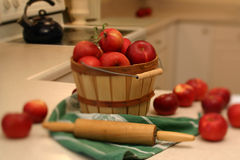 Bountiful harvest. Basket full of apples. narrow strip of focus down center of photograph gives the picture a dreamy idyllic feel Stock Images