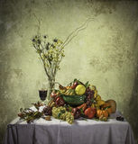 Bountiful Harvest. A still life composition showing the fruits, vegetables and flowers of the fall season Royalty Free Stock Image