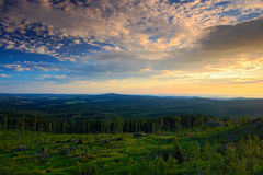Bountiful morning sunrise in the Sumava Mountain, chop down forest on the hill, nice clouds on the sky, Knizeci Stolec, Czech Repu Stock Photos